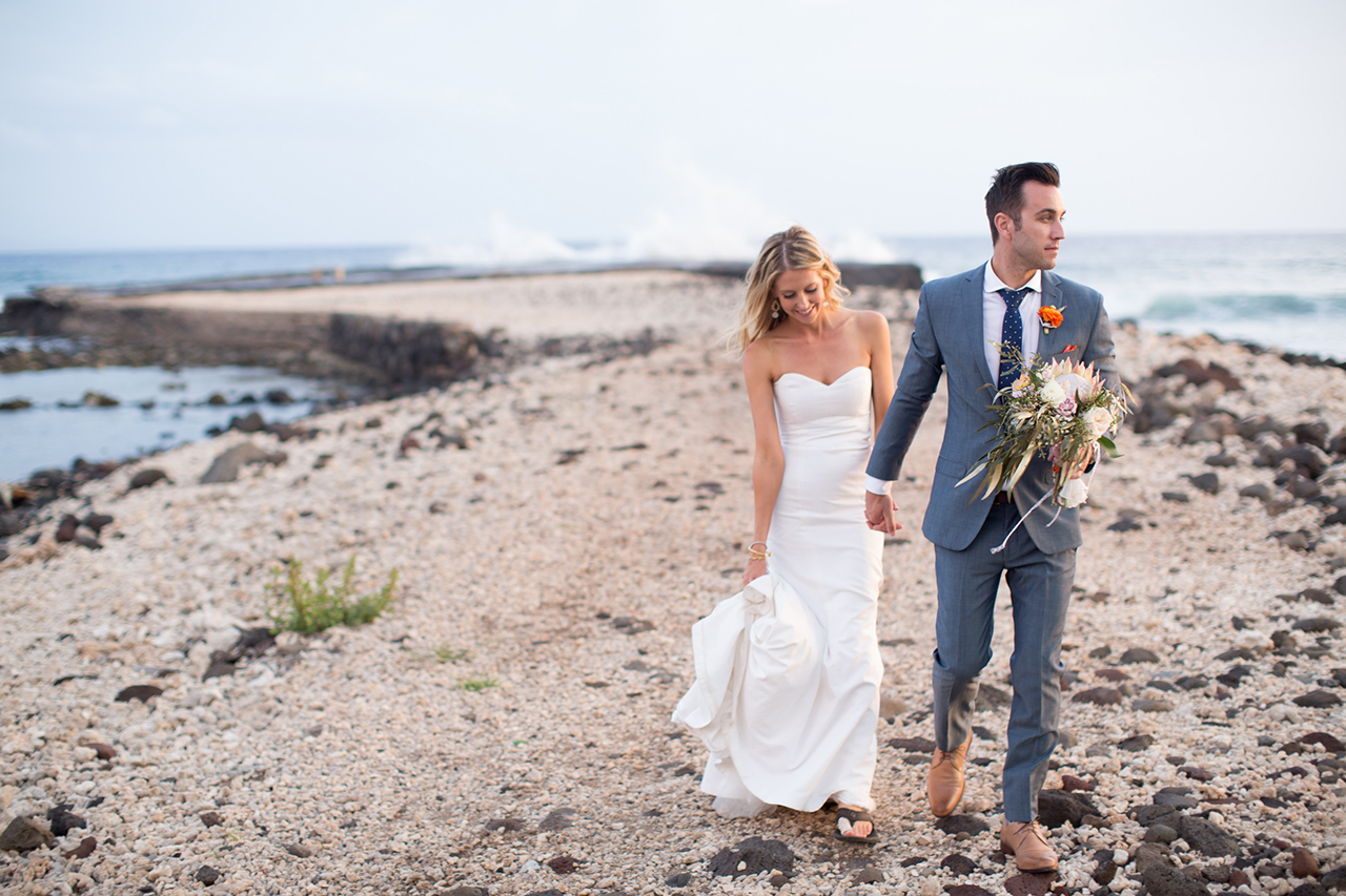 A couple are photographed strolling back from a pier at Olowlau Maui.