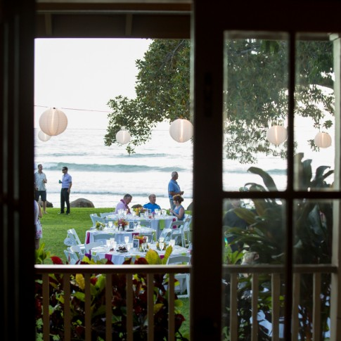 a picture looking out of a historic house at Olowalu to a wedding reception